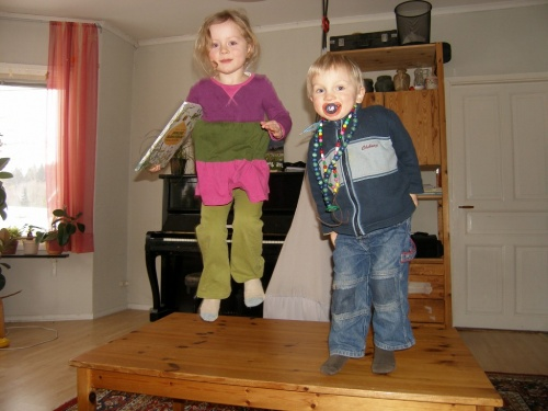 Two little monkeys jumping on the table